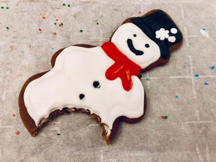 Bitten iced gingerbread snowman cookie