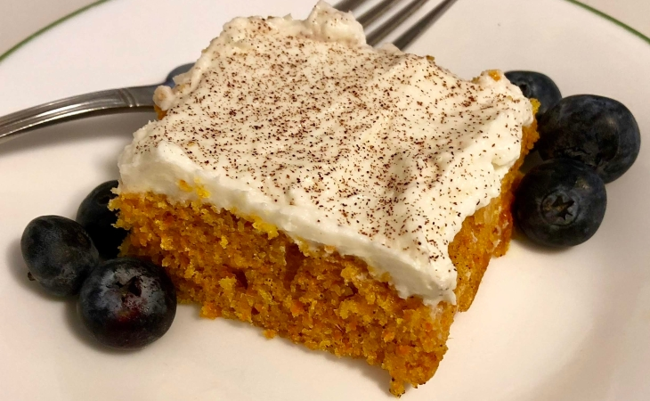 Frosted carrot cake on a plate