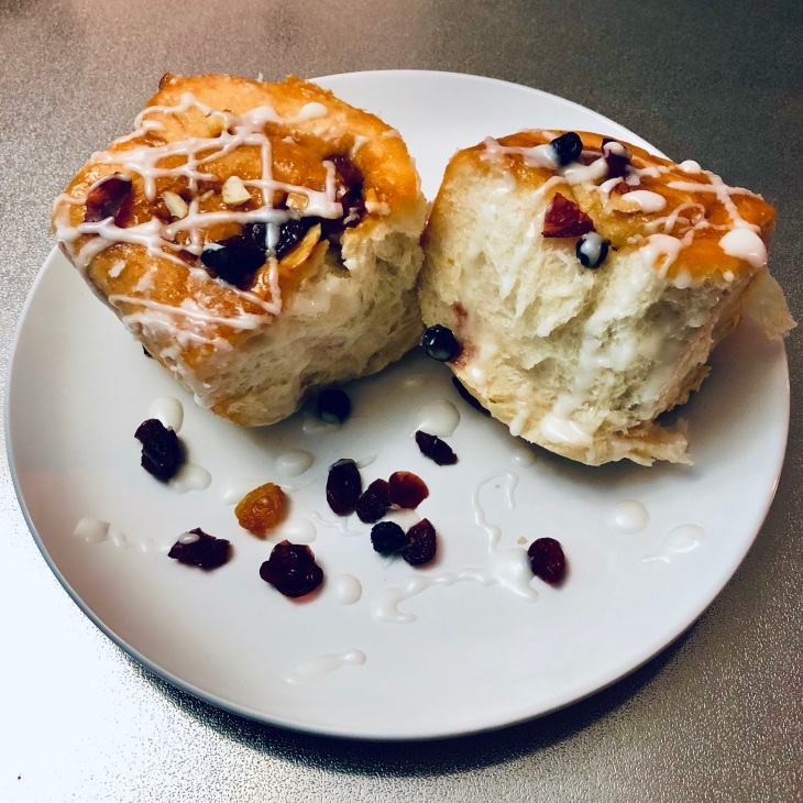 Two Chelsea buns filled with dried fruit