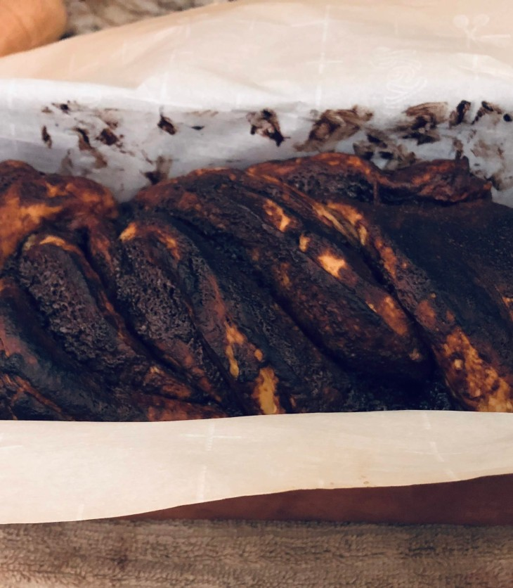 Chocolate babka cooling in a loaf pan