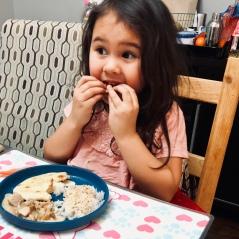 girl eating naan