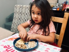 girl tearing into naan