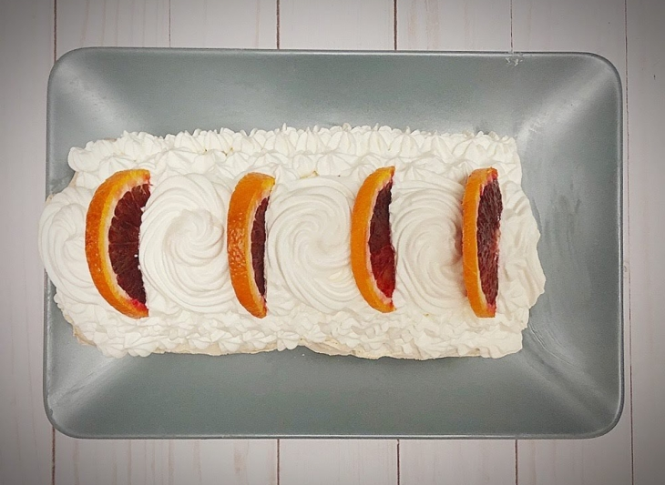 Meringue roulade topped with chantilly cream